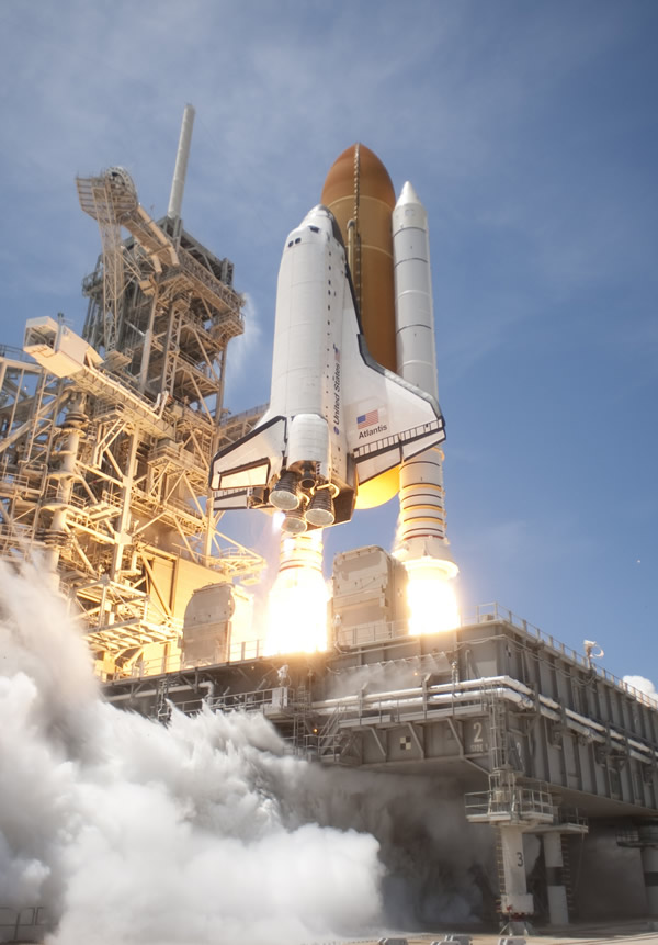 An exhaust plume surrounds the mobile launcher platform on Launch Pad 39A as space shuttle Atlantis lifts off on the STS-132 mission.